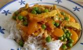 Geschnetzeltes mit Mandarinen und Erdnuss-Reis