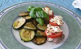 Mariniertes Schweinefilet mit Tomaten und Schafskäse überbacken mit Zucchini