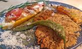 Zucchinschiffchen mit Parmesanchips und Pestodip
